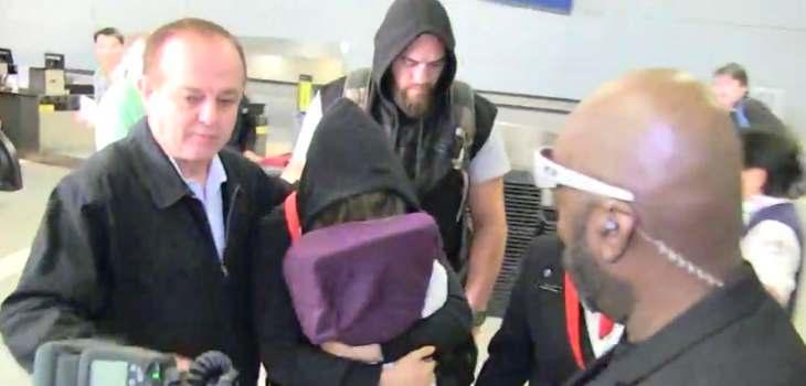 Ronda Rousey Hides Face